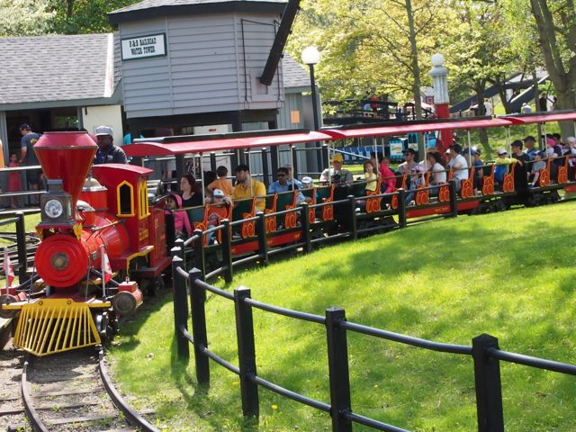 Kids riding a small train at an amusement park in Toronto, ON, Canada