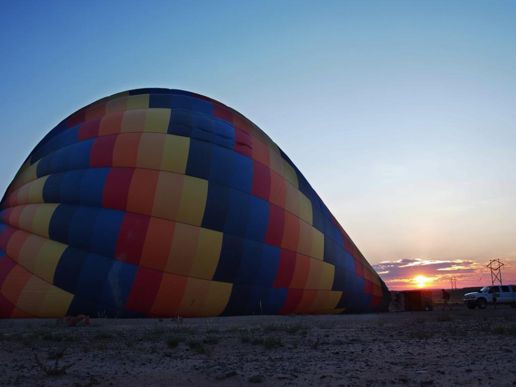 Hot air balloon ride at sunrise over the Utah desert.