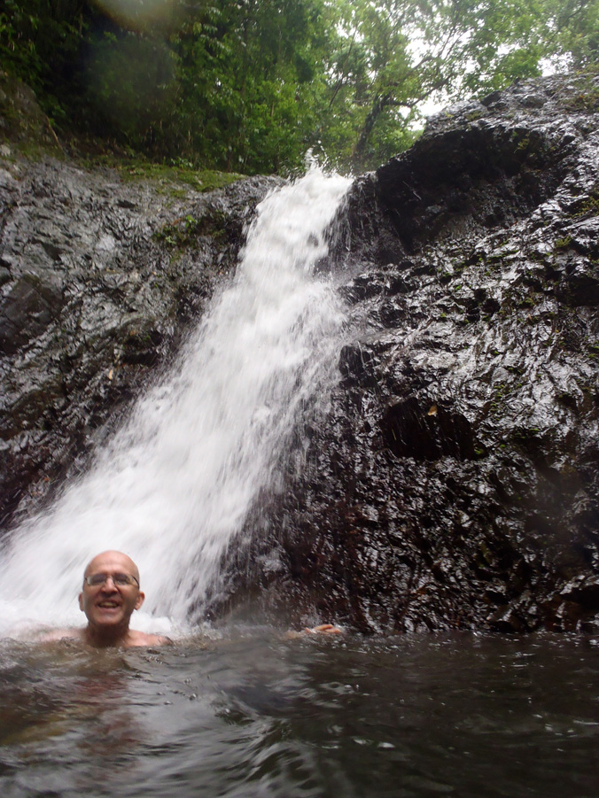 Swimming beneath a waterfall in Tobago, West Indies